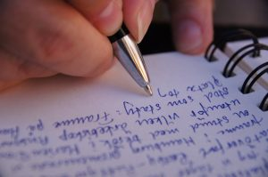 """""""diary writing"""" by freddie boy is licensed under CC BY-SA 2.0"""